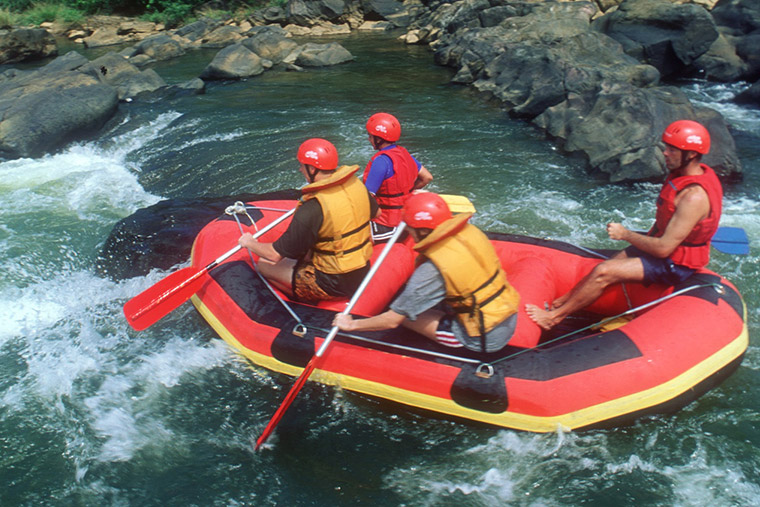 water rafting through tropical rainforests.